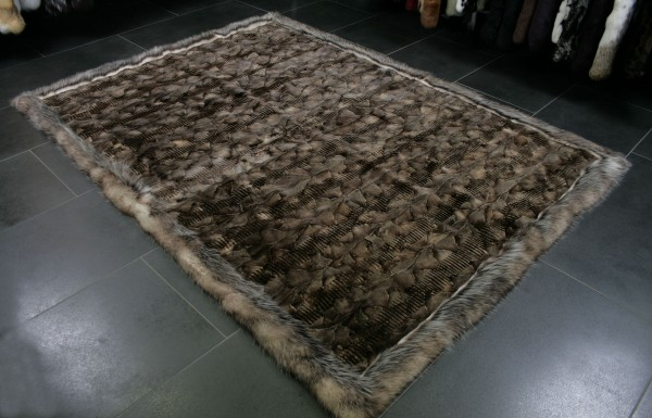 Fur rug from mink paws with a border of opossums