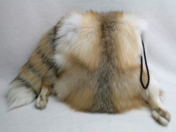 Fashionable muff made of golden island fox furs with tail and paws intact
