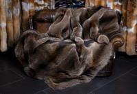 Manta de piel de mapache canadiense