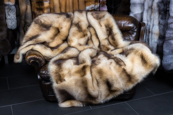 Handmade raccoon fur rug in beige-brown