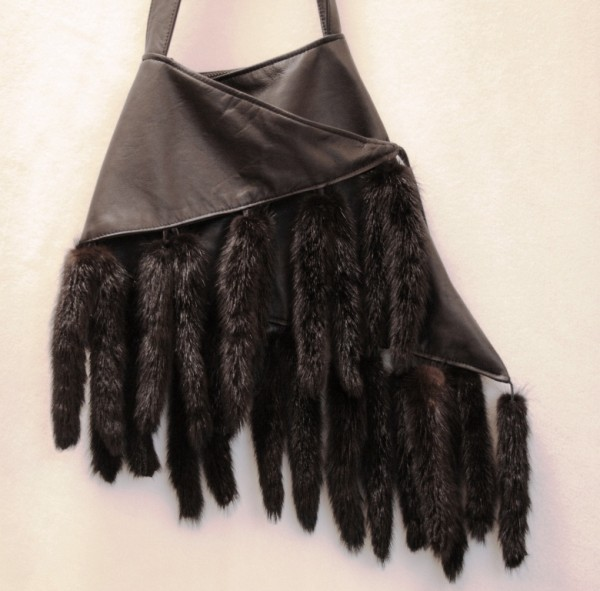 Luxurious fur handbag made from black nappa leather and mink tails