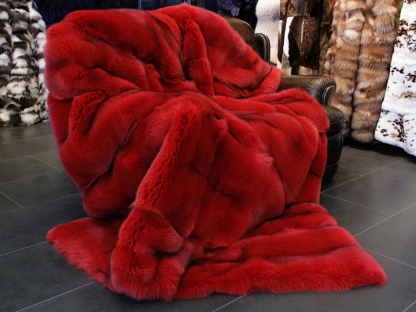 Blue fox fur blanket in Ferrari red